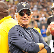 Legendary muscian and New Orleans Saints fan Jimmy Buffett watches the Saints beat the Seattle Seahawks from the Saints sideline Sunday Nov. 21,2010. The New Orleans Saints play the Seattle Seahawks Sunday Nov. 21, 2010 in New Orleans at the Super Dome. It is RB Reggie Bush's first game to play since breaking his fibula and Reggie is also playing against his old USC college Coach. Photo©SuziAltman.