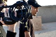 Salah Ameidan and Director/Camera Saeed Taji Farouky during the filming of The Runner.
