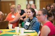 Eleanor Bishop listens to Gigi Secuban speak during the Women's Mentoring Meet and Greet event on Sept. 4, 2018 in Walter Rotunda. Photo by Hannah Ruhoff