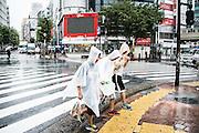 Kids walking under the rain. Typhoon number 10 called Lionrock hit japan early on morning, in Tokyo. 30/08/2016-Tokyo, JAPAN