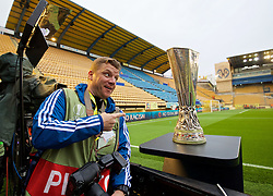 VILLRREAL, SPAIN - Thursday, April 28, 2016: Liverpool Echo photographer James Maloney with the UEFA Cup trophy before the UEFA Europa League Semi-Final 1st Leg match between Liverpool and Villarreal CF at Estadio El Madrigal. (Pic by David Rawcliffe/Propaganda)
