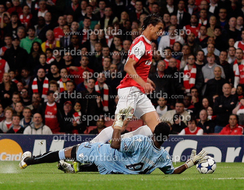 15.09.2010, Emirates Stadium, London, ENG, UEFA CL, Arsenal fc vs Sporting Braga, im Bild Arsenal's Marouane Chamakh is fouled in the box by     Felipe of Braga for the Arsenal penalty during Arsenal fc vs Sporting Braga for the UCL  Group  H at the Emirates Stadium in London. EXPA Pictures © 2010, PhotoCredit: EXPA/ IPS/ Marcello Pozzetti +++++ ATTENTION - OUT OF ENGLAND/UK +++++ / SPORTIDA PHOTO AGENCY