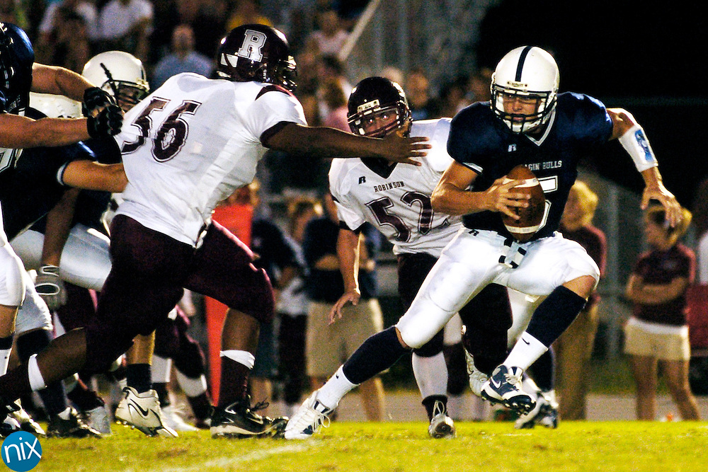 Hickory Ridge quarterback Brent Lilly scrambles before being sacked by Jay M. Robinson's Demarcus Luckey Friday, August 29, 2008. (photo by James Nix)