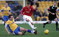 Photo: Paul Thomas.<br /> Mansfield Town v Walsall. Coca Cola League 2. 20/01/2007.<br /> <br /> Stephen Dawson (L) tackles Craig Pead of Walsall.