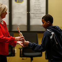 Thomas Wells | Buy at PHOTOS.DJOURNAL.COM<br /> Cindy Googe, left, presents Christopher Hooper with his trophy for winning this year's Lee County Spelling Bee on Thursday.