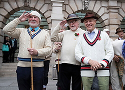 "© Licensed to London News Pictures. 09/11/2018. London, UK.  To mark Remembrance Day, members of the""Unshrinkables"" gather ahead of a drill practice in the Royal Academy of Arts Courtyard. At the outbreak of WW1 in 1914, the original members of the United Arts Rifles – a volunteer force comprised of artists from the Chelsea Arts Club – responded to a call to duty. The group didn't have uniforms, so they bought their own ""unshrinkable"" white woollen jumpers and hats, and drilled using wooden planks and broomsticks instead of guns. They paraded in the courtyard of the Royal Academy, and were given use of some of the galleries as a mess. The group has been in existence since 1914, and each Remembrance Day the members gather together to parade in the courtyard of The Royal Academy. Photo credit: Peter Macdiarmid/LNP"
