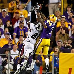 November 13, 2010; Baton Rouge, LA, USA; LSU Tigers cornerback Patrick Peterson (7) intercepts a pass over Louisiana Monroe Warhawks wide receiver Tavarese Maye (81) during the first half at Tiger Stadium.  Mandatory Credit: Derick E. Hingle