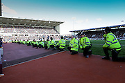 Police wait for the pitch invasion during the Sky Bet Championship match between Burnley and Queens Park Rangers at Turf Moor, Burnley, England on 2 May 2016. Photo by Simon Davies.