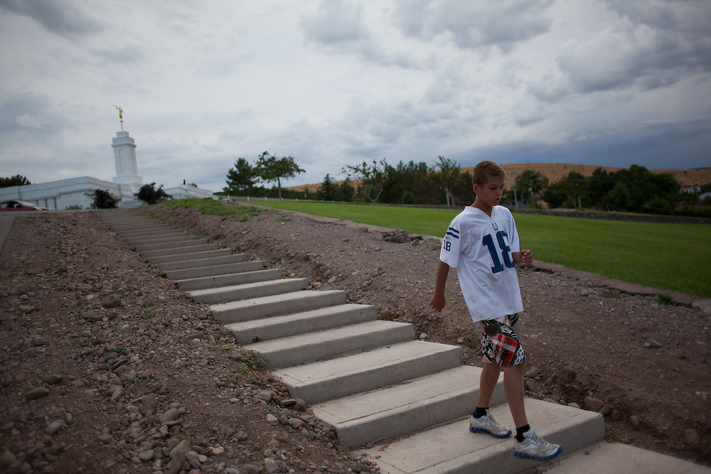 Gunner Romney, 11, walks down from the mormon temple down a large hill in Colonia Juarez, Mexico in July 2011. United States Presidential candidate Mitt Romney's family migrated to Mexico over 100 years ago after being granted asylum from Mexican President Porfirio Diaz after they had been pursued by the U.S. authorities for polygamy...(Romney is currently running for the Republican nomination.)