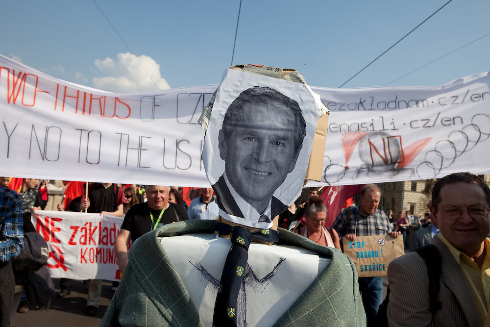 Demonstration against the planned US military radar base in Czech Republic on the day of Barack Obamas arrivel to Prague. Images of George W. Bush who was supporting the US radar base in Czech Republic.