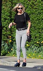 Supermodel Kate Moss wearing a black top, stripy trousers and a pair of clogs out enjoying the sunshine in north London, UK. 15/04/2015<br />