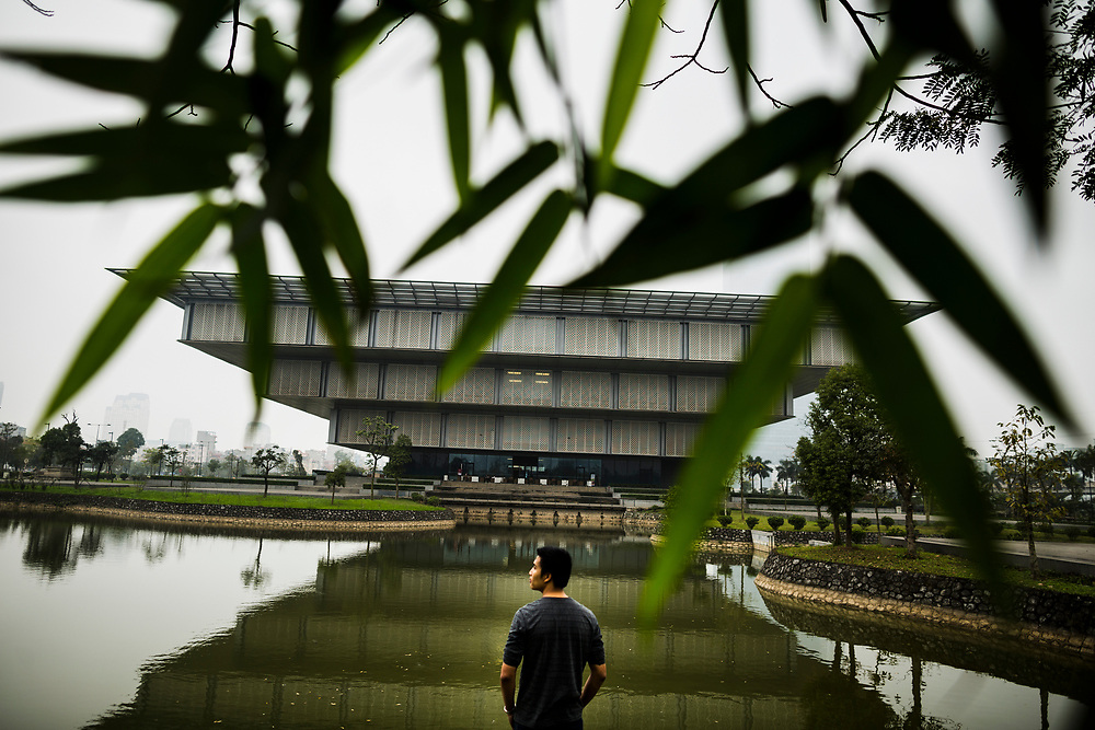 An exterior view through bamboo leaves of the Hanoi Museum in Hanoi, Vietnam.