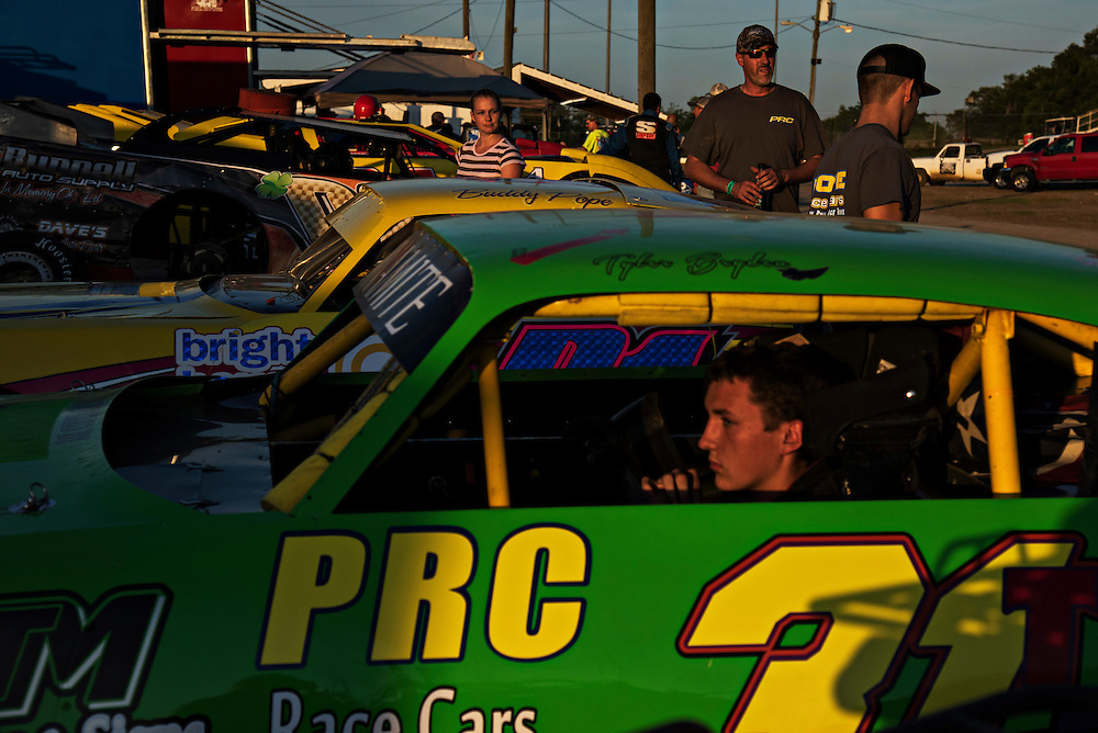 OCALA, FL - MAY 14, 2016:  <br /> <br /> As the sun sets on the pits, and they buzz and roar with life, Tyler Bryden (cq), 15, of Ocala, Fla. sits in his V-8 Thunder Stock car to collect his thoughts after returning from his Heat Race on the 3/8-mile dirt track Bubba Raceway Park in Ocala, Fla. Brides said he's been racing for about 4 years now.<br /> <br /> (Melissa Lyttle for the New York Times)