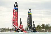 The Great Sound, Bermuda. 11th June 2017. Emirates Team New Zealand and Artemis Racing (SWE) fight for position at the finish of race six of the Louis Vuitton America's Cup Challenger playoff finals. ETNZ won the race to go ahead to 4 - 2.