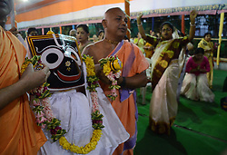 June 9, 2017 - Kolkata, West Bengal, India - Indian Hindu priests  carrying the idol God  Jagannath before the of holy Snan Yatra or bathing ceremony ahead of their Ratha Yatra or chariot festival in Kolkata , India on Friday, 9th June , 2017. (Credit Image: © Sonali Pal Chaudhury/NurPhoto via ZUMA Press)