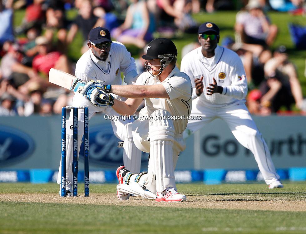 Jimmy Neesham plays a shot. First day, ANZ Boxing Day Cricket Test, New Zealand Black Caps v Sri Lanka, 26 December 2014, Hagley Oval, Christchurch, New Zealand. Photo: John Cowpland / photosport.co.nz