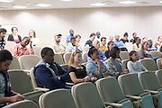 The audience listens to a panel discussion on the Ebola epidemic in West Africa on Friday evening, September 26 in Bentley Hall.