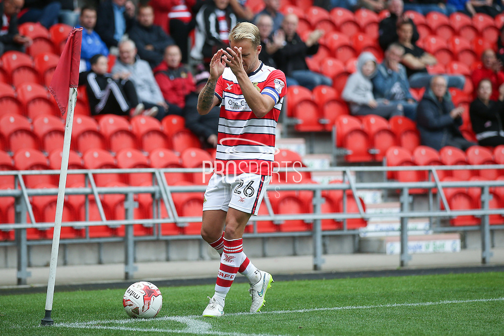 Doncaster Rovers midfielder James Coppinger (26)  applauds the fans before taking a corner during the EFL Sky Bet League 2 match between Doncaster Rovers and Newport County at the Keepmoat Stadium, Doncaster, England on 17 September 2016. Photo by Simon Davies.
