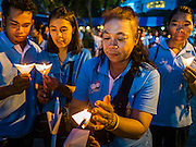 12 AUGUST 2016 - BANGKOK, THAILAND:      Thais participate in a candlelight vigil to honor Queen Sirikit of Thailand. Thais celebrated the Queen's birthday Friday. Queen Sirikit of Thailand, was born Mom Rajawongse Sirikit Kitiyakara on 12 August 1932. She married  Bhumibol Adulyadej, King of Thailand (Rama IX) in 1950. He is the longest serving monarch in the world and she is longest serving consort of a monarch. Her birthday, like the King's Birthday (which falls on Dec. 5),  is a national holiday in Thailand. Her birthday, August 12, is also celebrated as Mother's Day in Thailand.     PHOTO BY JACK KURTZ