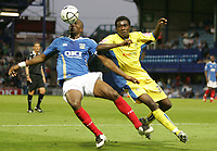 Photo: Lee Earle.<br /> Portsmouth v Leeds United. Carling Cup. 28/08/2007.Portsmouth's Sylvain Distin (L) battles with Tomi Ameobi.