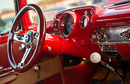 Bellmore, NY, USA. August 24, 2018. Red 1967 Chevy Bel Air Interior closeup includes steering wheel, instrument panel and customized gear stick knob at Bellmore Friday Night Car Show, in parking lot of LIRR Bellmore station.