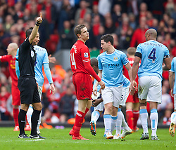 LIVERPOOL, ENGLAND - Sunday, April 13, 2014: Liverpool's Jordan Henderson walks off dejected after being shown a red card and sent off Manchester City during the Premiership match at Anfield. (Pic by David Rawcliffe/Propaganda)