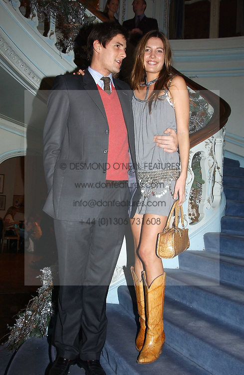 AMANDA SHEPPARD and RICHARD O'HAGAN at jewellers Tiffany's Christmas party held at The Savile Club, 69 Brook Street, London on 14th December 2004.<br />