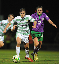 Yeovil Town's Sam Foley is tackled by Bristol City's Luke Ayling  - Photo mandatory by-line: Harry Trump/JMP - Mobile: 07966 386802 - 10/03/15 - SPORT - Football - Sky Bet League One - Yeovil Town v Bristol City - Huish Park, Yeovil, England.