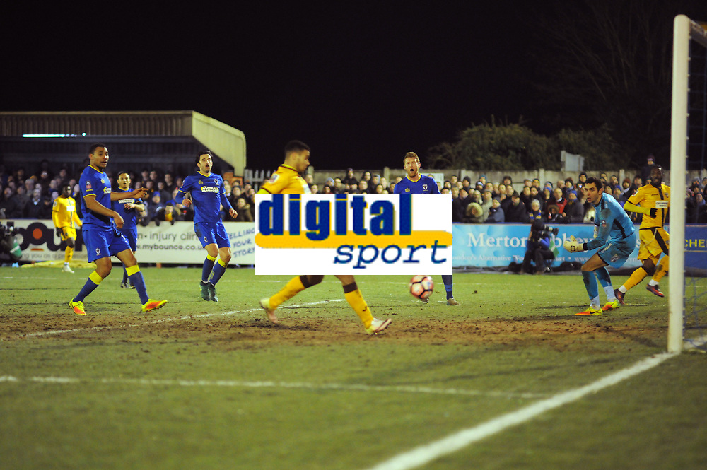 Football - 2016 / 2017 FA Cup 3rd rd Replay AFC Wimbledon vs Sutton United<br /> <br /> Roarie Deacon of Sutton lays the ball across the box for Maxime Biamou to score goal no 2 in injury time at The Cherry red records stadium.<br /> <br /> COLORSPORT/ANDREW COWIE