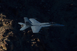 """US Navy Boeing F/A-18E Super Hornet NJ-276 from Strike Fighter Squadron 122 (VFA-122) the """"Flying Eagles"""" flies through the Jedi Transition over Rainbow Valley, Death Valley National Park, California, United States of America"""