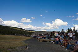 Spectators line up to watch the eruption of Old Faithful Geyser in Yellowstone National Park, Wyoming.