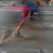 A blur of motion as runners feet make their way along First Avenue in Manhattan, New York, during the ING New York Marathon. New York, USA. 3rd November 2013. Photo Tim Clayton
