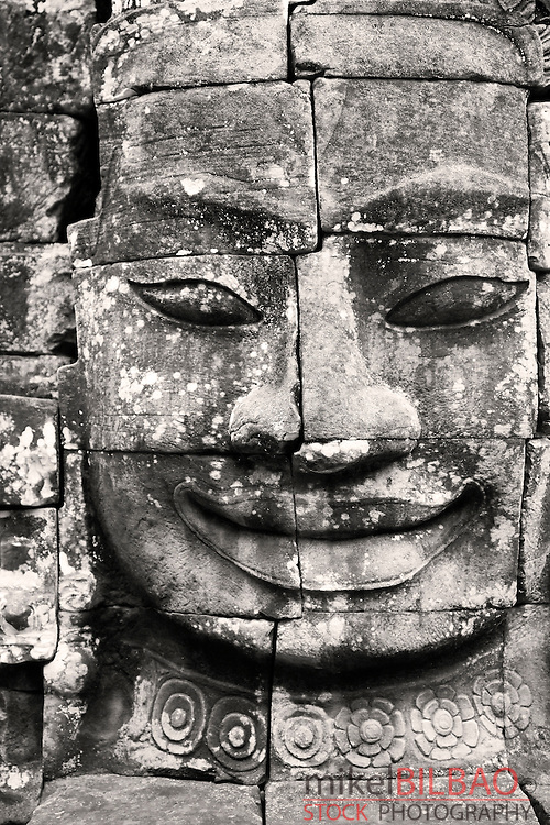 Stone head in Bayon temple, Angkor Thom.<br /> Angkor temples, Cambodia, Asia.