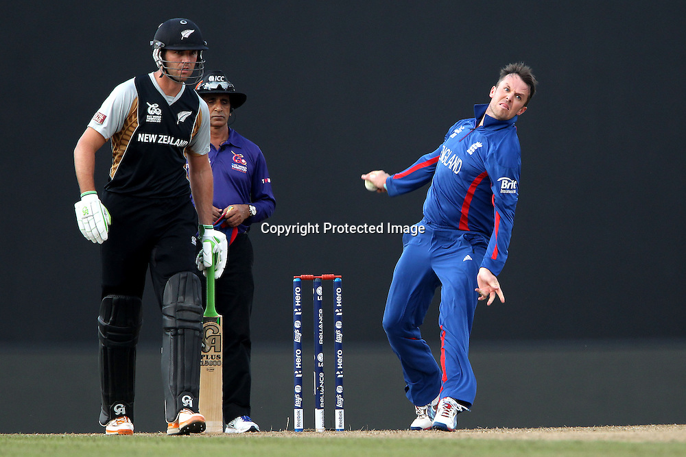 Graeme Swann of England bowls as James Franklin prepares to run during the ICC World Twenty20 Super 8s match between England and New Zealand held at the  Pallekele Stadium in Kandy, Sri Lanka on the 29th September 2012<br /> <br /> Photo byRon Gaunt/SPORTZPICS/PHOTOSPORT