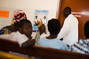 Patients in the waiting room of the NDA health center in Dimbokro, Cote d'Ivoire on Friday June 19, 2009.