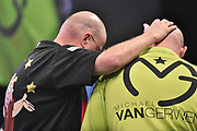 Raymond van Barneveld and Michael van Gerwen during the Betway Premier League Darts at the Manchester Arena, Manchester, United Kingdom on 23 March 2017. Photo by Mark Pollitt.