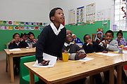 Pupils are attending to a lesson at the Tereo Mission School in Cape Town.