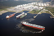 Supertanker leaving Oiltanking Houston, Inc. tank farm. Fuels move through this tank farm using a land based pipeline network and tankers. The tank farm is used for hydro-carbon trading, building and breaking bulk fuels, and oil refinery support.