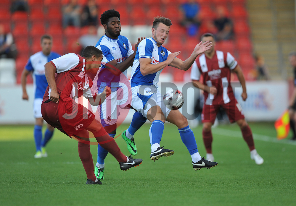 Bristol Rovers' Ollie Clarke closes down Cheltenham Town's Troy Brown  - Photo mandatory by-line: Alex James/JMP - Tel: Mobile: 07966 386802 15/07/2014 - SPORT - FOOTBALL - Whaddon Road- Cheltenham  -  Cheltenham Town V Bristol Rovers - preseason