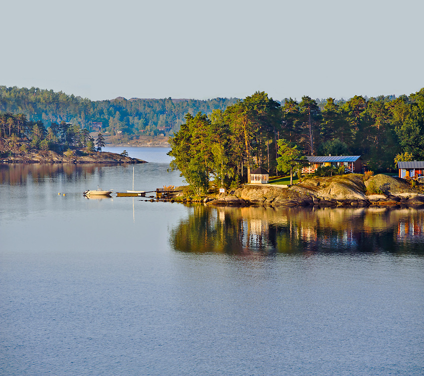 Cottages and pleasure boats are a common site along the islands of the Stockholm Archipelago on the Swedish coast. Here, they are seen from the Baltic Sea.