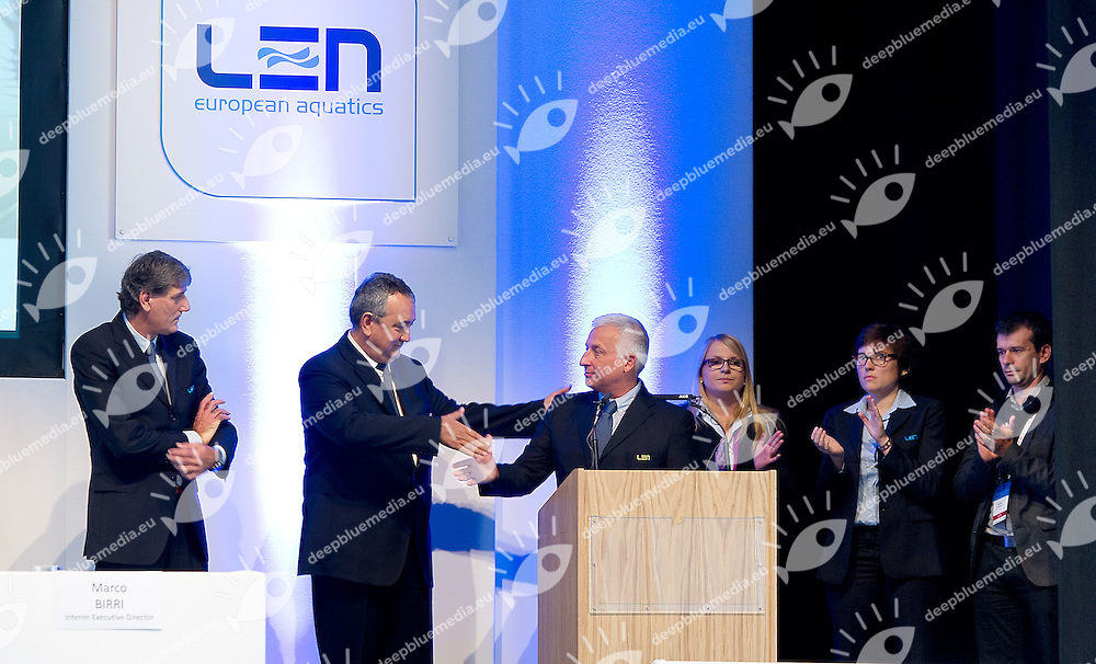 Paolo Barelli LEN President (middle -L) shaking hand with Paulo Frischknecht , newly appointed LEN Director (middle -R) among the LEN office staff <br /> LEN 50 th Congress<br /> Ligue Europeenne de Natation<br /> European Swimming Federation<br /> Edinburgh, Scotland GBR<br /> Sept. 28 2013<br /> Photo Giorgio Scala/Deepbluemedia.eu
