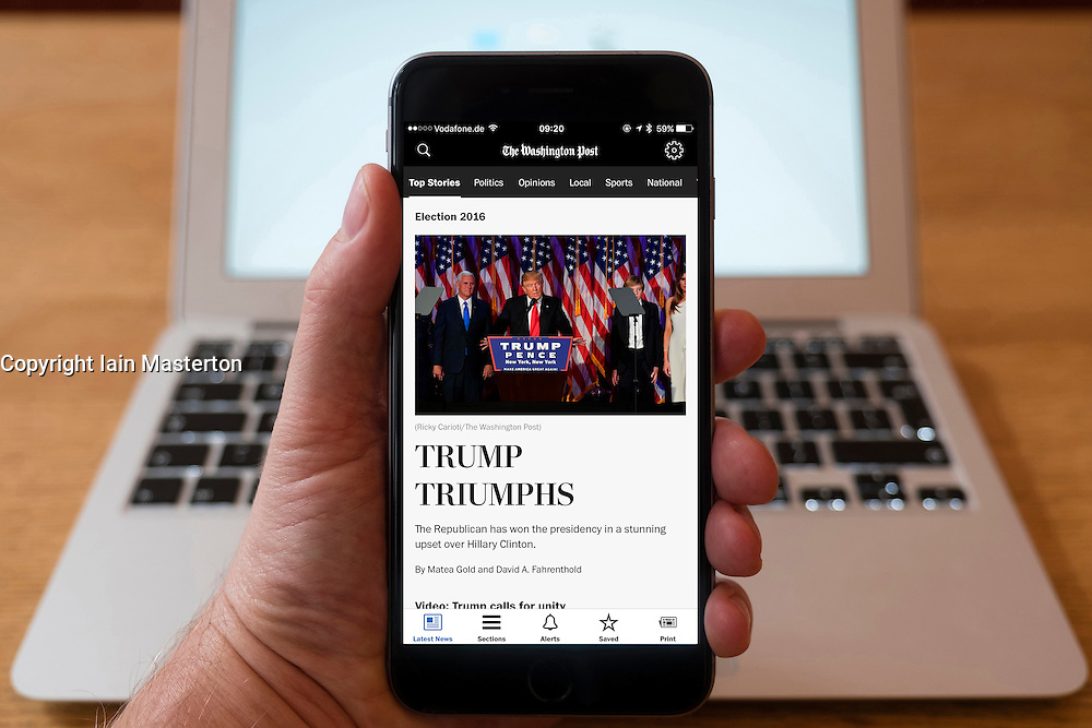 Detail of iPhone smart phone showing online mobile  newspaper front-page headline from The Washington Post following Donald Trump's victory in 2016 US Presidential Election