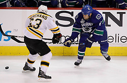 June 1, 2011; Vancouver, BC, CANADA; Vancouver Canucks defenseman Sami Salo (6) passes the puck past Boston Bruins left wing Brad Marchand (63) during the first period in game one of the 2011 Stanley Cup Finals at Rogers Arena. Mandatory Credit: Jason O. Watson / US PRESSWIRE