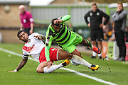 Forest Green Rovers Dan Wishart(17) is tackled by Newport County's Joss Labadie(4) during the EFL Sky Bet League 2 match between Forest Green Rovers and Newport County at the New Lawn, Forest Green, United Kingdom on 14 October 2017. Photo by Shane Healey.
