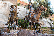 The life-sized statues of Don Quixote de la Mancha and Sancho Panza at the bottom of a rock cliff in the historic center of Guanajuato City, Guanajuato, Mexico.