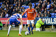 Chris Gunter and Diego Fabbrini during the Sky Bet Championship match between Reading and Birmingham City at the Madejski Stadium, Reading, England on 22 April 2015. Photo by Adam Rivers.