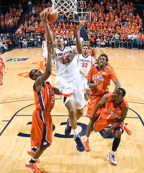 Virginia guard Sylven Landesberg (15) shoots over Clemson guard Demontez Stitt (2).  The Virginia Cavaliers defeated the #12 ranked Clemson Tigers in overtime 85-81 at the John Paul Jones Arena on the Grounds of the University of Virginia in Charlottesville, VA on February 15, 2009.
