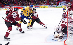 15.05.2012, Ericsson Globe, Stockholm, SWE, IIHF, Eishockey WM, Schweden (SWE) vs Lettland (LVL), im Bild Sverige Sweden 4 Staffan Kronwall (Severstal Cherepovets), Latvia 60 Juris Stals (Dinamo Riga), Latvia 11 Kristaps Sotnieks (Dinamo Riga), Latvia 1 Goalkeeper Maris Jucers (Dinamo Riga) // during the IIHF Icehockey World Championship Game between Schweden (SWE) vs Latvia (LVL) at the Ericsson Globe, Stockholm, Sweden on 2012/05/15. EXPA Pictures © 2012, PhotoCredit: EXPA/ PicAgency Skycam..***** ATTENTION - OUT OF SWE *****