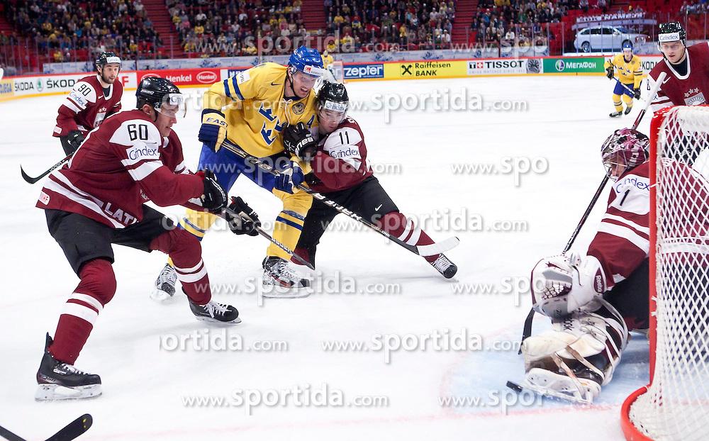 15.05.2012, Ericsson Globe, Stockholm, SWE, IIHF, Eishockey WM, Schweden (SWE) vs Lettland (LVL), im Bild Sverige Sweden 4 Staffan Kronwall (Severstal Cherepovets), Latvia 60 Juris Stals (Dinamo Riga), Latvia 11 Kristaps Sotnieks (Dinamo Riga), Latvia 1 Goalkeeper Maris Jucers (Dinamo Riga) // during the IIHF Icehockey World Championship Game between Schweden (SWE) vs Latvia (LVL) at the Ericsson Globe, Stockholm, Sweden on 2012/05/15. EXPA Pictures © 2012, PhotoCredit: EXPA/ PicAgency Skycam..***** ATTENTION - OUT OF SWE *****