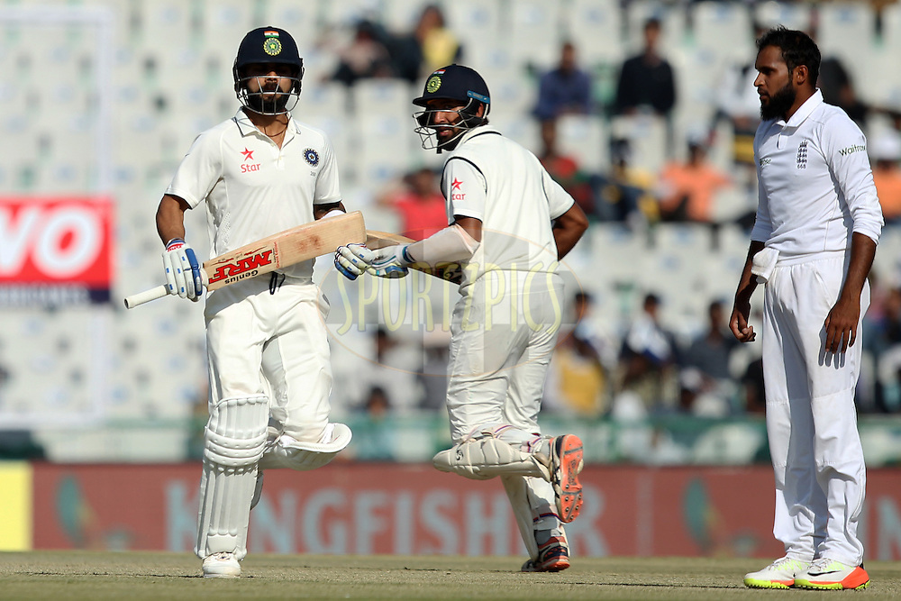 Virat Kohli captain and Cheteshwar Pujara of India running between the wicket during day 2 of the third test match between India and England held at the Punjab Cricket Association IS Bindra Stadium, Mohali on the 27th November 2016.Photo by: Prashant Bhoot/ BCCI/ SPORTZPICS